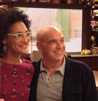 Carla Hall and Michael Symon smile for pictures after the show