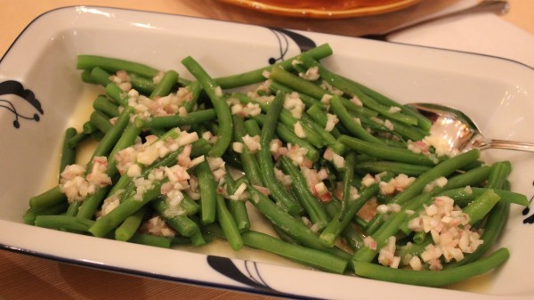 Steamed string beans dressed with a mustard-shallot vinaigrette
