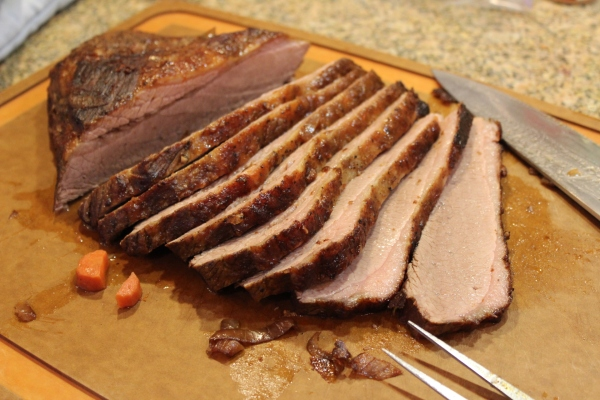 Brisket on the board, sliced and moist, ready for serving